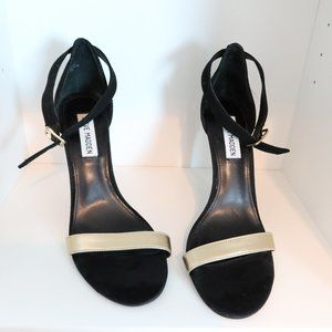 black strap heel with gold strap across the top.